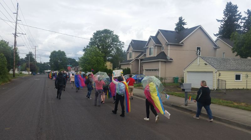 PMG PHOTO: RAYMOND RENDLEMAN - North Clackamas School District students paraded through Oak Grove neighborhoods in a route that spanned about half of a mile.