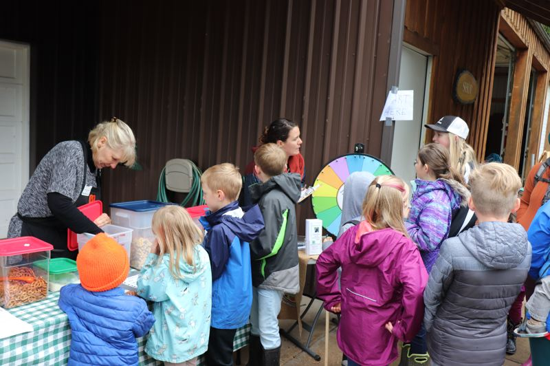 COURTESY PHOTO - Kids spin a wheel then answer questions about healthy snacks before making trail mix.