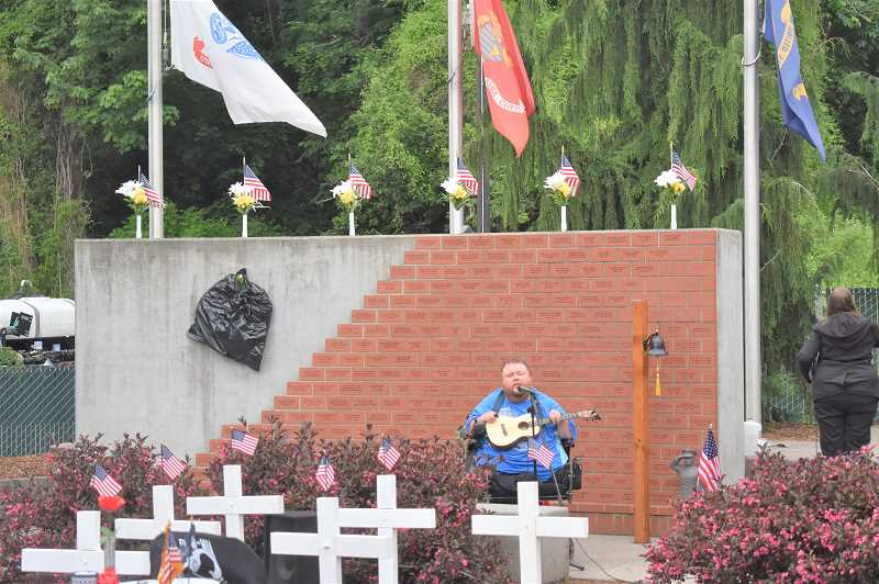 PMG PHOTO: EMILY LINDSTRAND - Enoch Stalcup sings the National Anthem during the annual Estacada Memorial Day ceremony earlier this week.