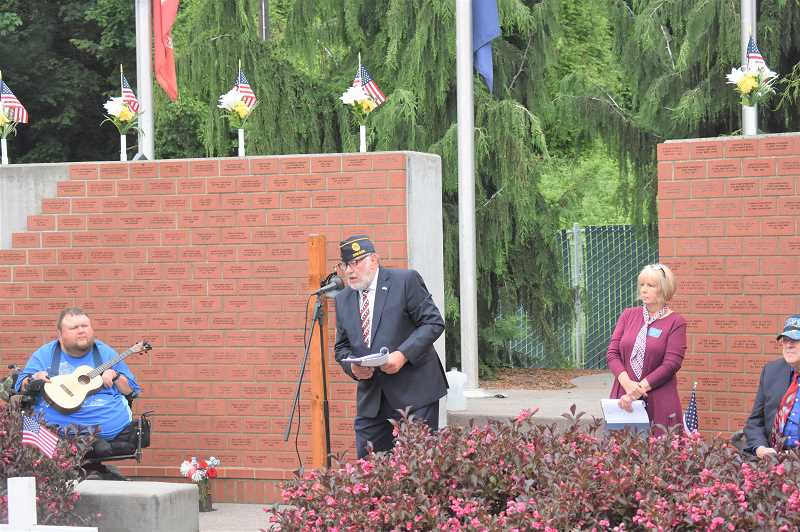 PMG PHOTO: EMILY LINDSTRAND - Dennis Dahrens of the Estacada Area Support Our Troops Foundation speaks during a Memorial Day ceremony earlier this week.