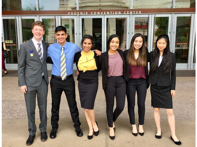 COURTESY PHOTO - From left, ISEF finalists Nathan Tidball, Neel Jain, Pooja Jain, Rishima Mukherjee, Marlee Feltham and Jessica Yu present their science projects in Phoenix.