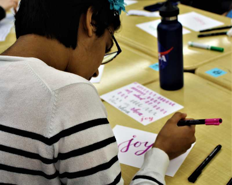COURTESY PHOTO: KALEIGH HENDERSON - Sophomore Rhea Grover attends the calligraphy and positive words workshop.