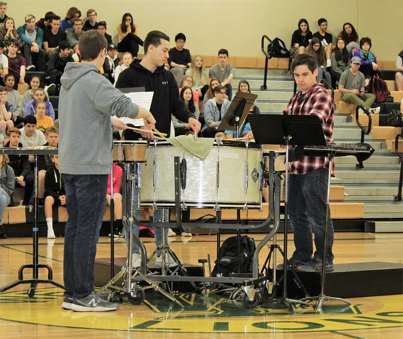COURTESY PHOTO: KALEIGH HENDERSON - Noah Wenig, Andre Chenevert and Jordan Buser play at the morning assembly during Unity Day.