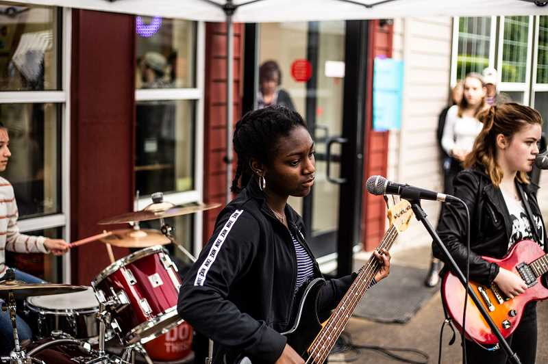 COURTESY PHOTO - Sunset High School junior Morgan Page, center, joined Love Circle two months ago and plays bass, guitar and sings backup vocals.