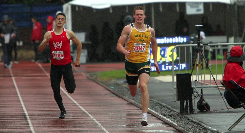 PMG PHOTO: MILES VANCE - West Linn senior Garrett Jackson speeds to the finish line in the 400 meters during the Class 6A state track and field meet at Mt. Hood Community College on Saturday, May 25, at the .
