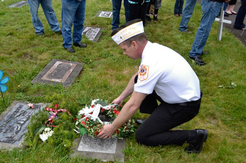 PMG PHOTO: BRITTANY ALLEN - Local VFW officers decorated veteran Alan Gunderson's grave as part of the Memorial Day ceremony.