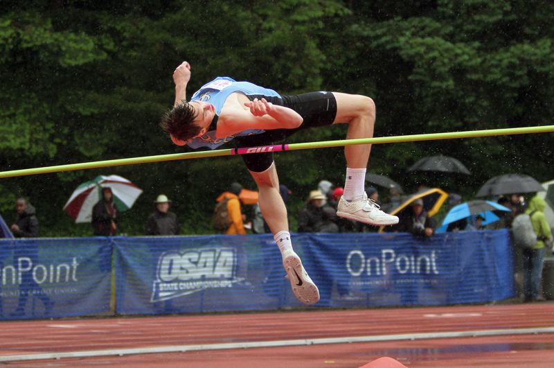 PMG PHOTO: MILES VANCE - Lakeridge senior Calvin Migchelbrink competes in the high jump during the Class 6A state track and field meet at Mt. Hood Community College on Saturday, May 25.