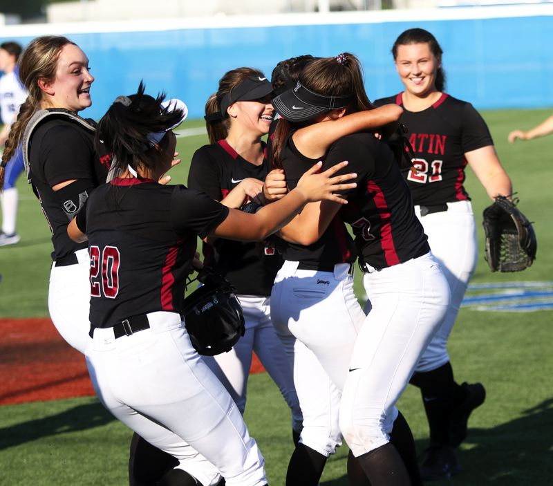 PMG PHOTO: DAN BROOD - Tualatin's (from left) Leanna Rosenbaum, Kaylee Mo, Andrea Gomez, Tia Ridings, Savannah Braun and Emily Johansen celebrate following the 10-7 semifinal victory at Grants Pass.