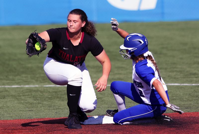 PMG PHOTO: DAN BROOD - Tualatin senior shortstop Emily Johansen (left) grabs the ball as Grants Pass junior Kylee Rucker slides to second base during Tuesday's state playoff semifinal game.