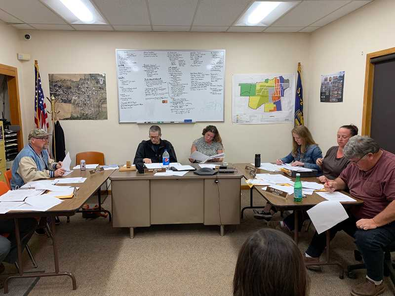 PMG PHOTO: GEOFF PURSINGER - The Gaston City Council meets during a budget committee meeting on May 15. City employees have asked the council to ban some members from entering City Hall amid accusations of harassment and bullying.