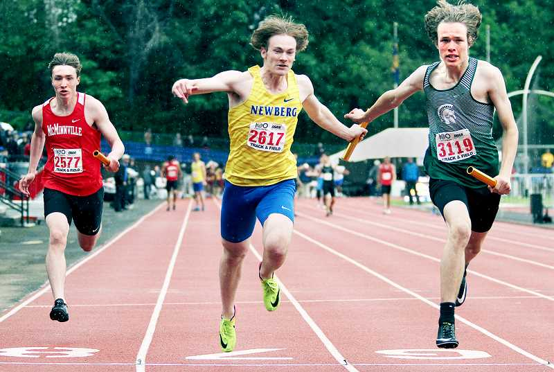 PMG PHOTO: MILES VANCE  - Newberg's 4 x 100 team, led by junior Riley Beecroft, finished 11th at state in 43.75 seconds.
