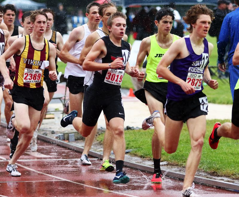PMG PHOTO: DAN BROOD - Tualatin High School junior Andrew Payton (3019) stays with the pack during the 1,500-meter run at the Class 6A state track and field championships.