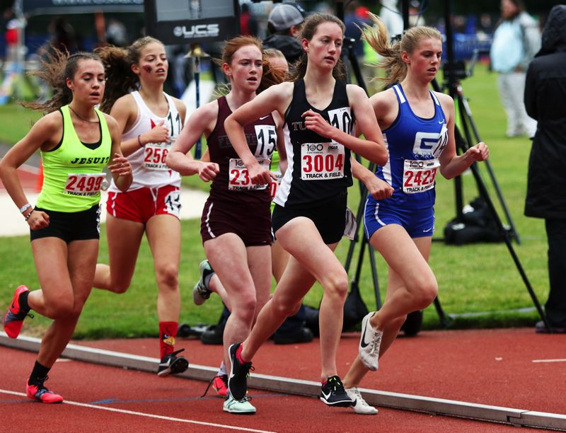 PMG PHOTO: DAN BROOD - Tualatin High School junior Kaitlyn Gearin (3004) keeps up the pace during the 3,000-meter run at the Class 6A state track and field championships.