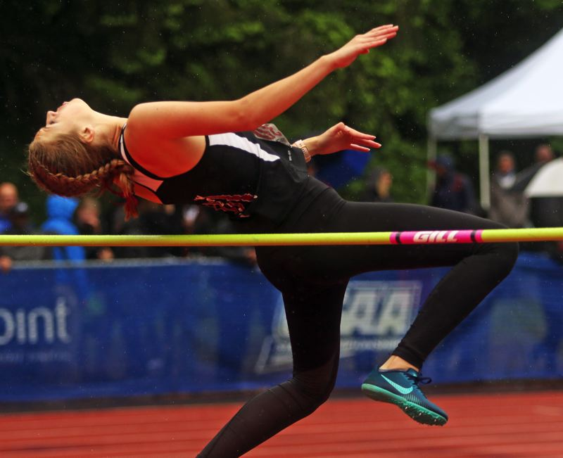 PMG PHOTO: DAN BROOD - Tualatin High School sophomore Ellie Hammond placed seventh in the high jump competition at the state meet with a mark of 5-2.