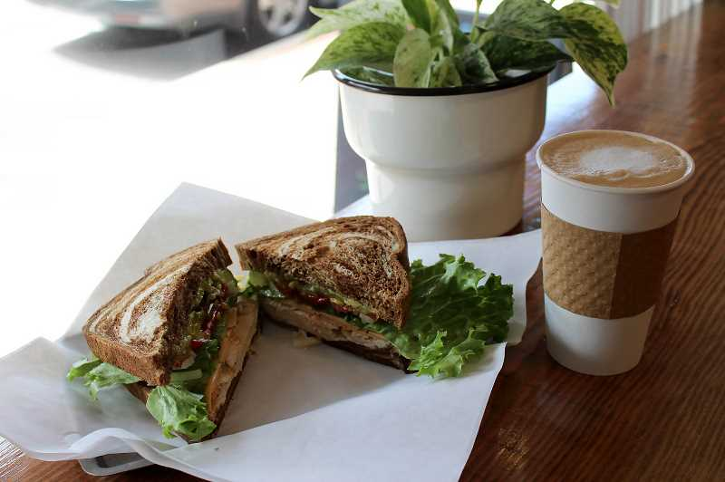 PMG PHOTO: SHELBY COKELEY - Good Intentions' current monthly special is a curry chicken sandwich with creamy Havarti cheese. Daily specials are shared via Facebook post and written on their sign outside each morning.