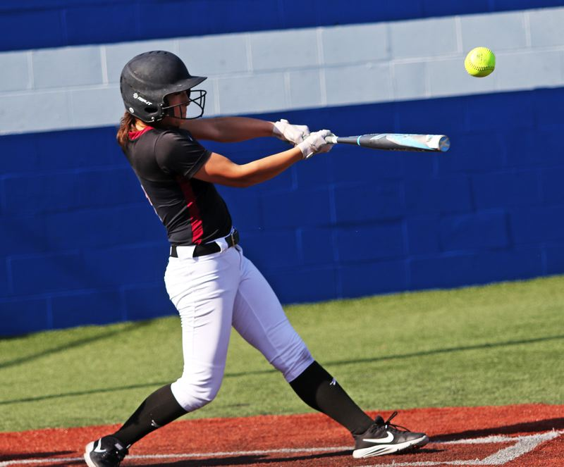 PMG PHOTO: DAN BROOD - Tualatin High School senior Lily Marshall smacks the ball during the Timberwolves' 10-7 win at Grants Pass.