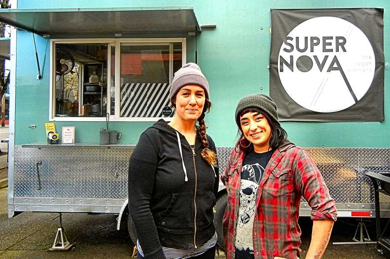 ELIZABETH USSHER GROFF - Woodstock Supernova Vegan food cart owner Lindsay Sligh (left) and her employee Hannah Halford persevere in extreme weather. That may be a useful attribute if it gets especially hot this summer.
