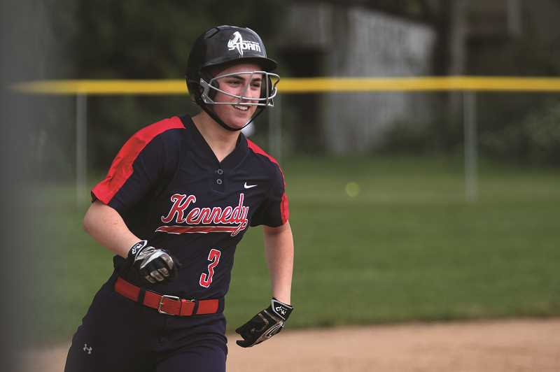 PMG PHOTO: PHIL HAWKINS - Kennedy junior Grace Schaecher rounds the bases after hitting her second consecutive home run against the Glide Wildcats on May 24. Teammate Elise Suing concluded the game with a walkoff grand slam.