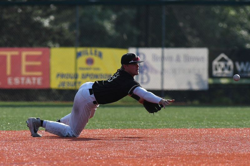 COURTESY PHOTO: BRIAN MURPHY - Jesuit senior shortstop Will Spitznagel flips a ball to second base for a big out against South Salem.
