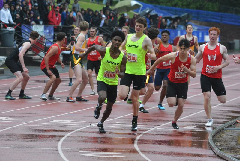 TIMES PHOTO: MATT SINGLEDECKER - Jesuit sprinter Michael Brittingham ran the third leg of the Crusaders triumphant 4x400 relay last week.