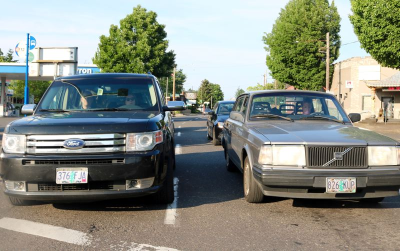 PMG PHOTO: ZANE SPARLING - Cars line up at a traffic light on Sandy Boulevard in Northeast Portland.