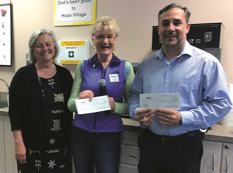 CAROL ROSEN - Hope Village resident Delette Huffman (center) presented check to Kathy Robinson (left) and Ray Keen (right) for use with their nonprofits. Robinson will use her $490 for food at the Canby Adult Center and Keen said his funds will focus on health, education, recreation, faith and life skills at The Canby Center.