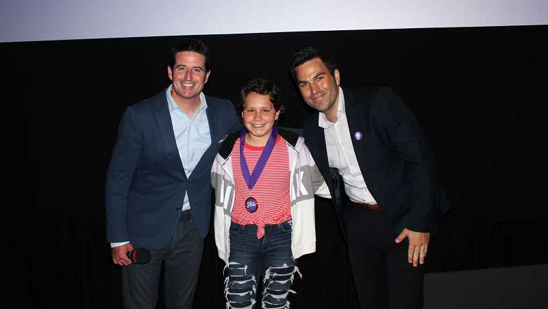CHILDRENS CANCER ASSOCIATION - Aubryana Ramirez of Woodburn, center, dons her Hero Award medal at the Celebration of Courage event. With Aubry are Jack Pipkin, VP Business Development & National Partnerships, CCA and Drew Carney, News Personality, KGW.