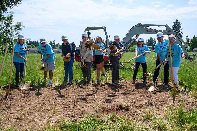 PMG PHOTO: CHRISTOPHER OERTELL - City councilors and parks commissioners officially break ground on the new Community Center at 53rd Avenue on Wednesday, May 29.