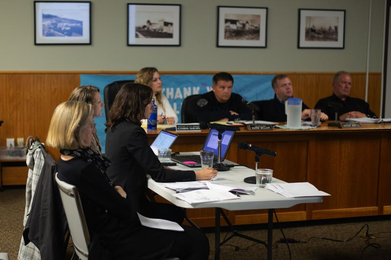 PMG PHOTO: ANNA DEL SAVIO - ECONorthwest consultants Lorelei Juntunen and Becky Hewitt asked the Scappoose City Council to approve aspects of the proposed urban renewal plan at the councils May 20 meeting. Approval would allow Elaine Howard, front, to prepare the formal plan.