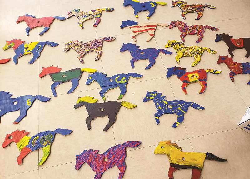 PHOTO COURTESY OF ASHLEY SMITH   - The colorful mustangs will decorate the fences near the Crooked River Elementary front parking lot.