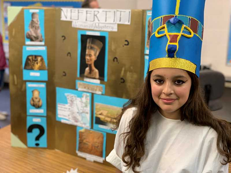 PHOTO BY JENNI BURKE - Eighth grader Diamond Amya dressed as Queen Nefertiti of Egypt for the Madras Christian School's open house.