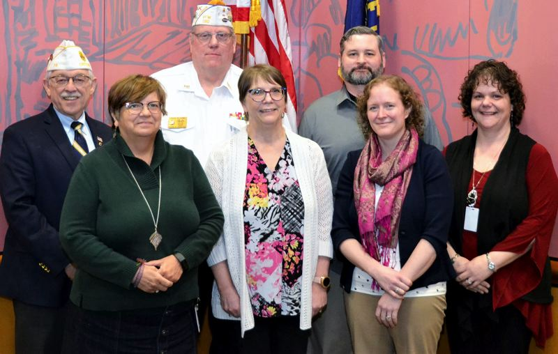 COURTESY PHOTO: DEPARTMENT OF STATE LANDS - Members of a state committee altering DSL rules on military medals were, front from left, DSL staff Pam Klecker, Carolyn Harris, Kim Olson and Anne Friend; back from left, S. Flynn Phillips of the American Legion Department of Oregon, David Lowe of  Veteran of Foreign Wars Post 180 and Joseph Bell of the state Department of Veterans Affairs.