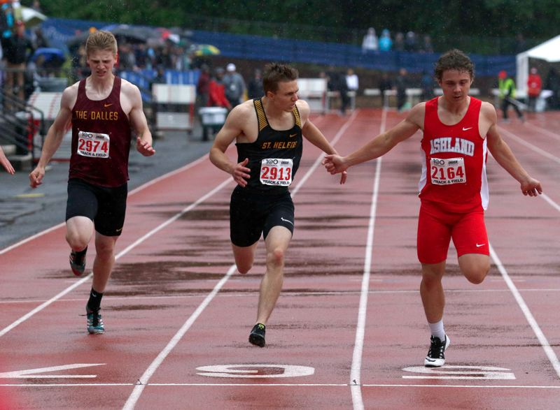 PMG PHOTO: JONATHAN HOUSE - Logan Page (center) of St. Helens takes third in the state boys 200 meters at Mt. Hood Community College.