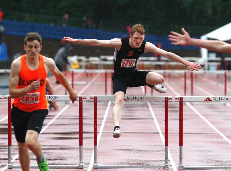 PMG PHOTO: JONATHAN HOUSE - Brisyn Maller of Scappoose competes in the 110-meter boys hurdles at the Class 5A track and field championships in Gresham. He placed fourth in this event as well as in the 300 hurdles.