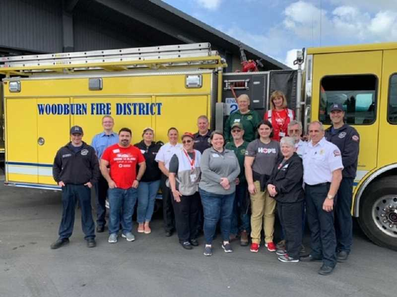 COURTESY OF WOODBURN FIRE DISTRICT - Woodburn Fire District saw more than 90 volunteers turn out and pitch into Smoke Alarms Save Lives.