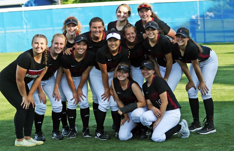 PMG PHOTO: DAN BROOD - The Tualatin High School softball team is all smiles following Tuesday's dramatic 10-7 state playoff semifinal win at Grants Pass. Pictured are (back row, from left) Camille Schmitz, Emily Johansen, Leanna Rosenbaum, Ella Hoyle, (center row) Taylor Corcoran, Nicole Webb, Lily Marshall, Kaylee Mo, Tia Ridings, Sydney Wagner, Savannah Braun, (front row) Bella Valdes and Andrea Gomez.