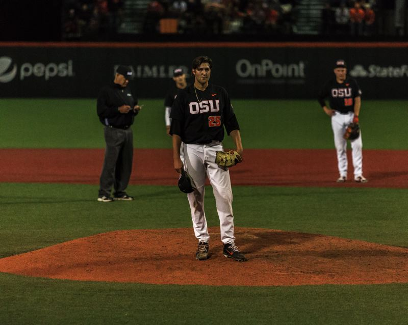 COURTESY PHOTO: MEGAN CONNELLY - Oregon State reliever Joey Mundt watches as Cincinnati rallies late en route to a 7-6 victory Friday night at Goss Stadium on the first day of the NCAA regional round.
