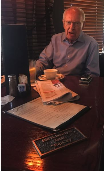 PMG PHOTO: KERRY EGGERS - Bill Schonely celebrates hitting age 90 with lunch at his table inside Oswego Grille in Wilsonville.