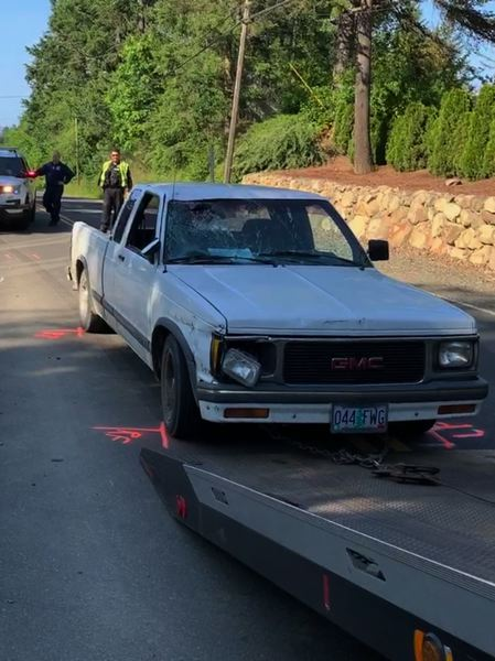 WSCO PHOTO - Washington County deputies tow the small pick-up truck that allegedly struck a cyclist from behind on Old Highway 47 on Friday, May 31.