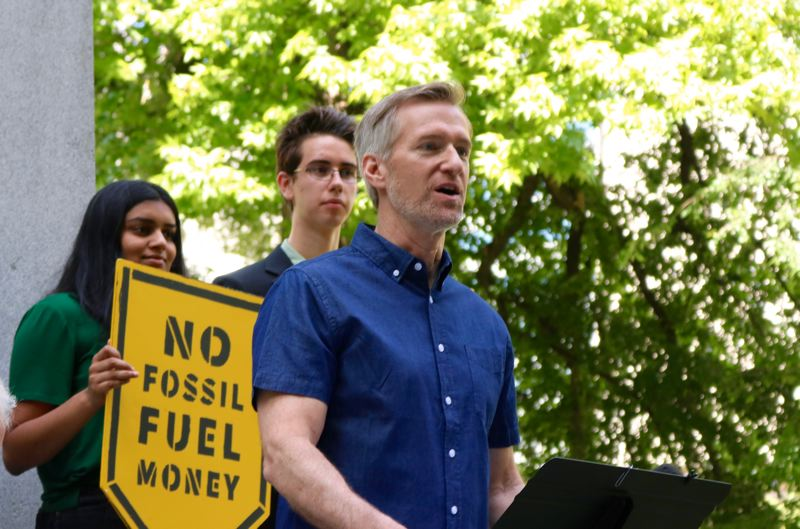 PMG PHOTO: ZANE SPARLING - Portland Mayor Ted Wheeler speaks during a downtown Portland rally supporting the plaintiffs in Juliana v. United States