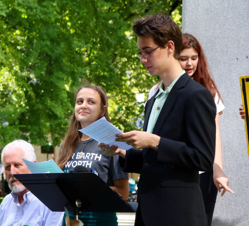 PMG PHOTO: ZANE SPARLING - Rex Putnam freshman Jackson Calhoun and Wilson freshman Serena Best-Prostrednik speak during a rally supporting the plaintiffs in Juliana v. United States during a rally on June 1.