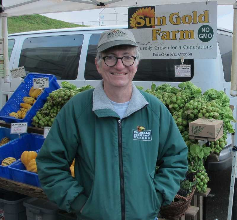 PMG PHOTO: BILL GALLAGHER - Hillsdale Farmers Market manager Eamon Molloy making the rounds in the Reike Elementary parking lot.