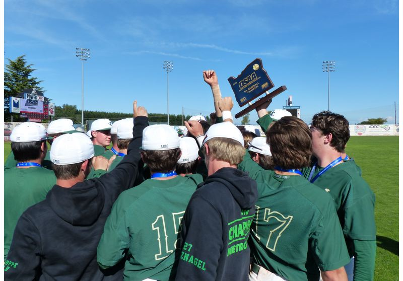 PMG PHOTO: KYLE GARCIA - Jesuit players break their huddle with the Class 6A trophy at Volcanoes Stadium after a 13-inning victory over Central Catholic.