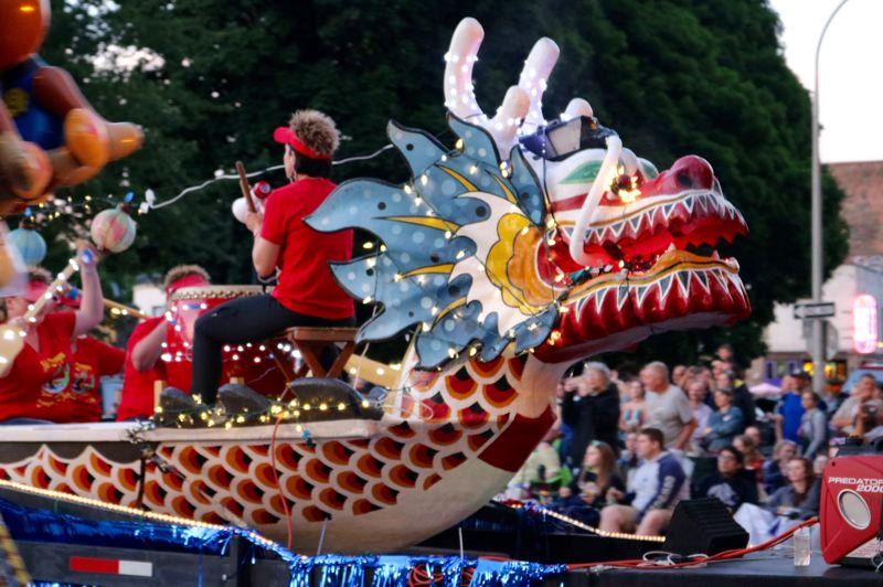 PMG PHOTO: ZANE SPARLING - A light-festooned Dragon Boat rows its way through Old Town/Chinatown during the 2019 Starlight Parade in Portland on Saturday, June 1.