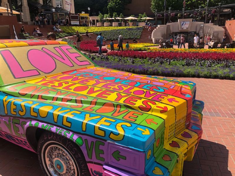 PMG PHOTO: MARK GARBER - A custom painted art car accents the floral displays at the Festival of Flowers.