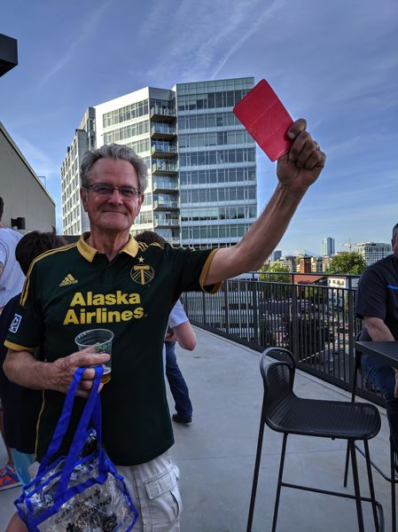 PMG: JOSEPH GALLIVAN - Hanging out on the Duracell Deck was a Timbers Army regular, Charlie Raymond, who had strolled in from the North End and took the elevator to the fourth level.