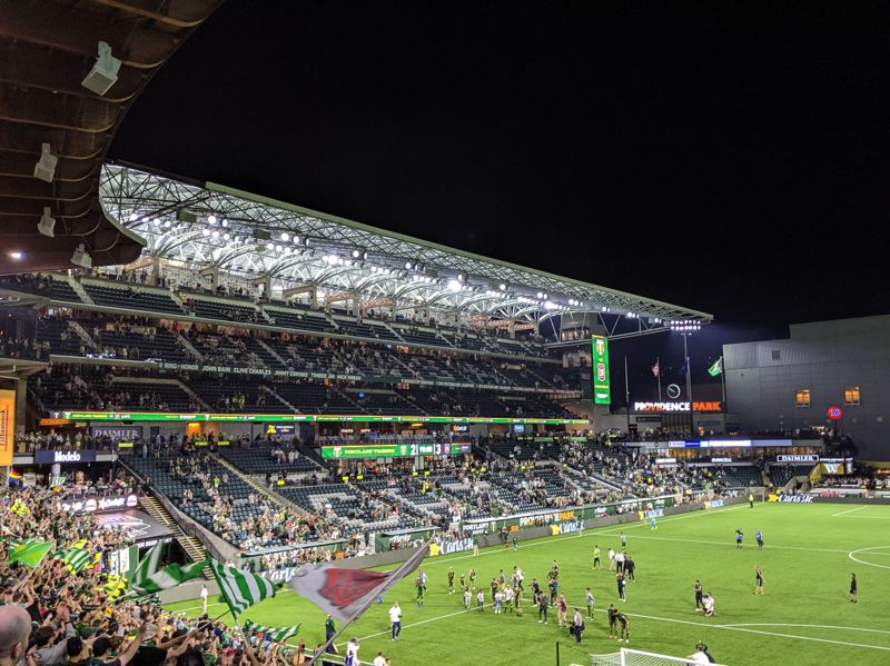 PAMPLIN MEDIA GROUP: JOSEPH GALLIVAN  - Timbers goalscorers coming for their log slices at the end of the defeat. The new stand emptied out rapidly thnks to ample stairways and two elevators.