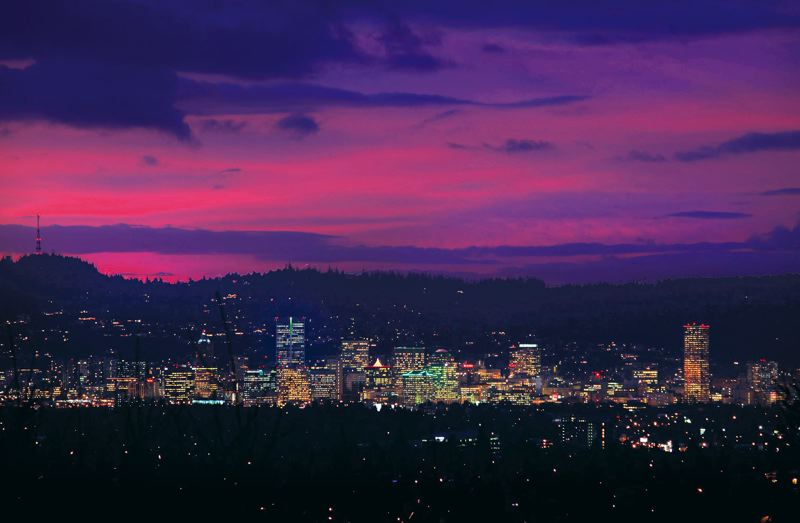 FILE PHOTO - Downtown Portland office towers light up the skyline.