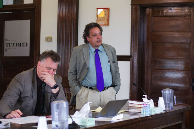 PMG PHOTO: ANNA DEL SAVIO - Timothy Rock Pizzo, standing, appears in front of retired Oregon Supreme Court Justice Richard Baldwin in Columbia County Circuit Court during a sentencing hearing for felony and misdemeanor drug charges Wednesday, May 22. Pictured at left is his attorney, Mark Lang.