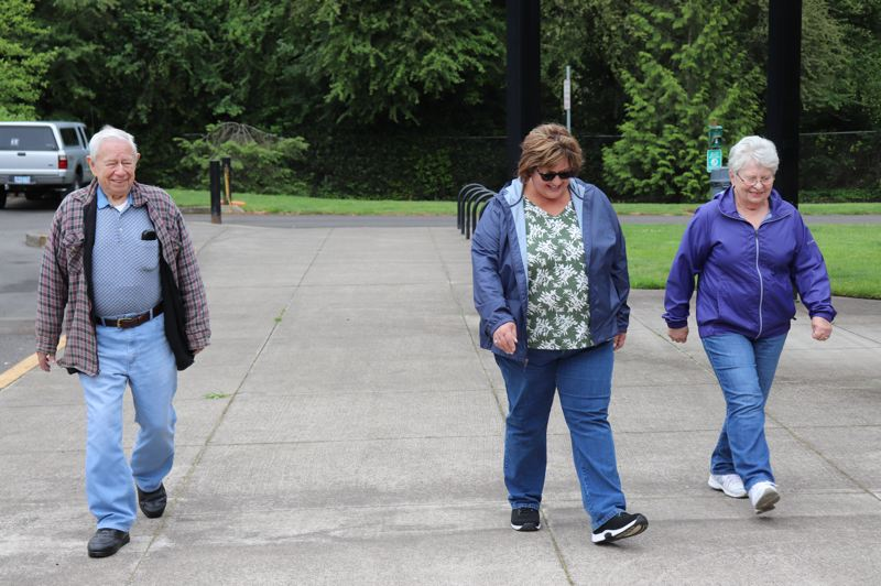 Robert Wiesner, Crystal James and Karen Schiller lead the pack during the walking portion of the Walk With Ease program.